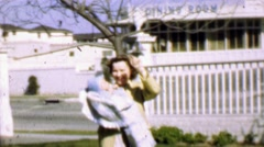 1957: Mother baby enjoying sunshine classic dining room supper club. - stock footage