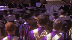 Stock Video Footage of 1964: Anxious college graduate crowd waiting to be awarded.