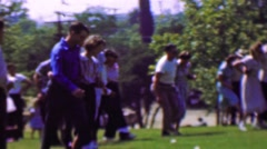 1957: 3 legged couples marriage counseling ball kicking cooperation game. - stock footage