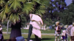 1957: Cross dressing adult fun charity competition race outfit swap. - stock footage