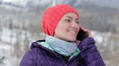 Attractive woman talking on cellphone in the mountains HD Stock Footage