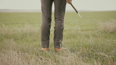 A man with an ax in the field Stock Footage
