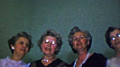 1957: Lovely senior women's group singing classic religious hymns. - stock footage