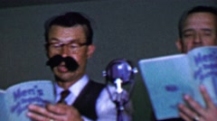 1957: Men's Get Together Songs book barbershop quartet performance. Stock Footage