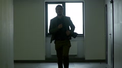 Young businessman running in office corridor or lobby in slow mo, slow motion. Stock Footage