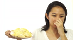 Asian girl can not stand the smell of stinky durian. Smelly fruit - stock footage