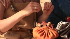 Ancient Woman is Sewing with a Needle at Historical Festival Stock Footage