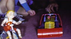 1957: Boy plays toy tractor farm plow tricycle pretty doll. Stock Footage