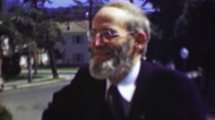 1958: Old bearded amish style man boyishly excited in society. - stock footage