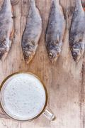 beer and fish on the table top view vertical background - stock photo