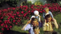 1957: Dad carry baby rides dangerous shoulder grip posture. Stock Footage