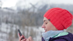 Attractive woman texting with her mobile phone in the mountains HD Stock Footage