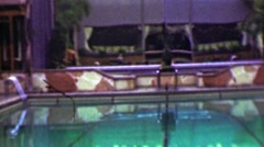 1958: Hotel resort pool lounge chair relaxation vacation fun zone. Stock Footage