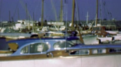 1958: Wood paneled yacht boats in harbor marina docking waters. Stock Footage