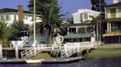 1958: Wealthy waterfront residential homes private docks boats. Stock Footage