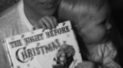 1958: Night Before Christmas bedtime story book reading. Stock Footage
