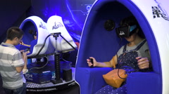 Chinese people play video games with virtual reality glasses in Shenzhen Stock Footage