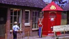 1962: Kid walking through Solvang Danish Days cottage exhibit. Stock Footage
