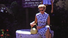 1962: Mature women taking break touring Santa Ines Mission. Stock Footage