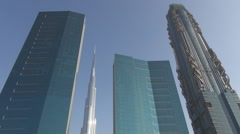 Famous Burj Khalifa tall tower in Dubai city landmark modern futuristic icon day Stock Footage
