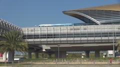 Metro train depart from Dubai station public transportation on suspended railway Stock Footage