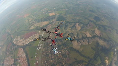 Skydiving friends making 2 figures - stock footage