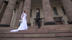 The groom kisses the bride suits and Stock Footage