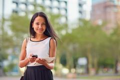 Using her on the go business apps Stock Photos