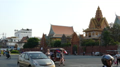 Stock Video Footage of Busy traffic around Wat Ounalom at the riverside of Phnom Penh