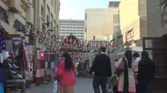 Bur Dubai local market in old town people visit famous arabic souk marketplace  Stock Footage
