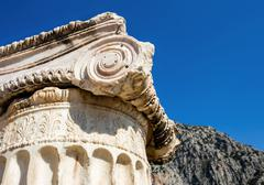 capital of Ionian order column in Ancient Delphi - stock photo