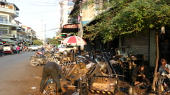 Motorbike and car repair shop on the street downtown Phnom Penh Stock Footage