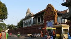 Traffic around Wat Ounalom in Phnom Penh Cambodia Stock Footage