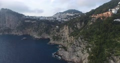 BEAUTIFUL AERIAL FLY OVER OF CAPRI CITY, MONESTARY AND ROCK CLIFFS Stock Footage