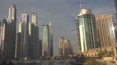 Pan right of luxurious Dubai Marina bay with skyscraper dock residential area  Stock Footage