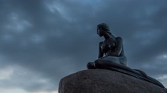 Timelapse of clouds over the Little Mermaid statue Stock Footage