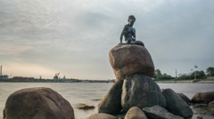 Timelapse of clouds and water by Little Mermaid statue Stock Footage