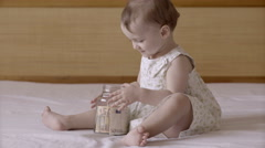 Children with money in glass jar Stock Footage