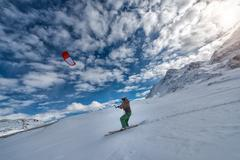 St. Moritz, Switzerland, 19 February 2016: Man practice snowkiting with ski Stock Photos
