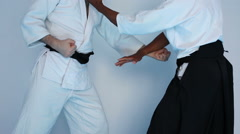 Stock Video Footage of Two men in black hakama practice Aikido on martial arts training