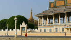 Monks walking in front of the Moonlight Pavilion at the Royal Palace Park Stock Footage