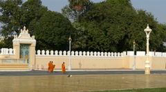 Monks walking at the Royal Palace Park in Phnom Penh Cambodia Stock Footage