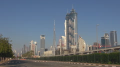 Famous Dubai tall tower building panorama and metro train transit people commute Stock Footage