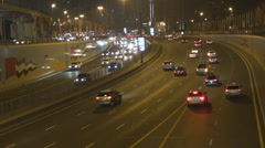 Busy freeway in Dubai downtown people commute on busy Sheikh Zayed Road by night Stock Footage