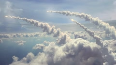 Ballistic Missiles, flying above the clouds. Stock Footage