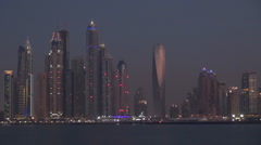 Timelapse of nightfall Marina modern skyscraper in Dubai skyline panorama emblem - stock footage