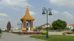 Statue of King Father Norodom Sihanouk with the Independence Monument - stock footage