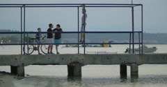 Teenagers group on the pier Stock Footage