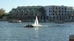 A man flying with a hydro jet pack on - Lake Havasu City Stock Footage