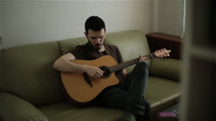 A handsome young man playing the guitar Stock Footage